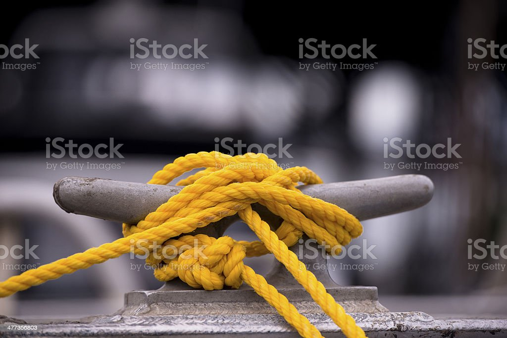 Yellow mooring rope on the hook stock photo