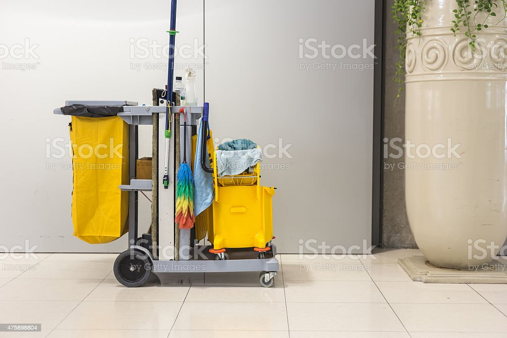 Yellow mop bucket and set of cleaning equipment stock photo