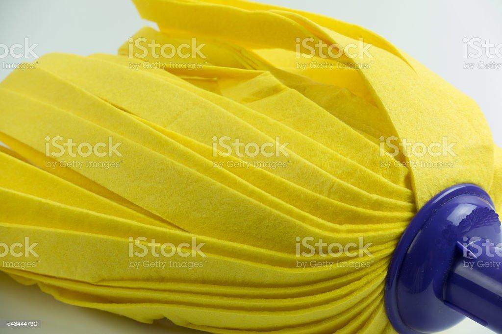 Yellow mop on white background. stock photo