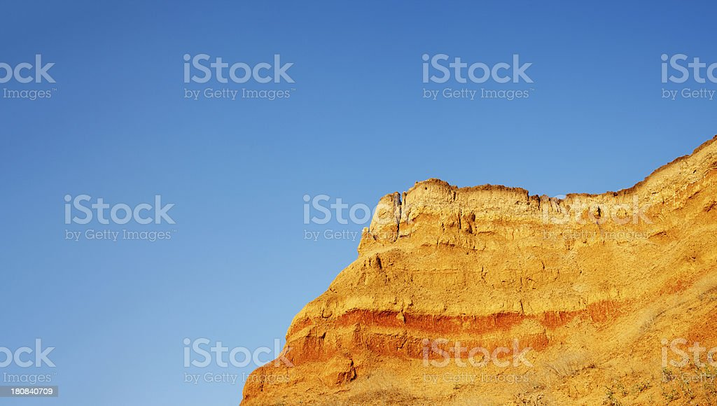yellow mountain on a background of blue sky royalty-free stock photo