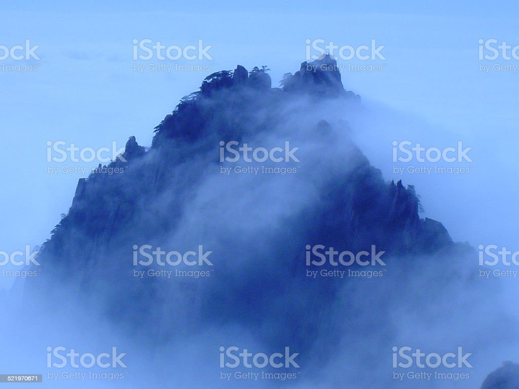Yellow mountains in china hidden in mist stock photo