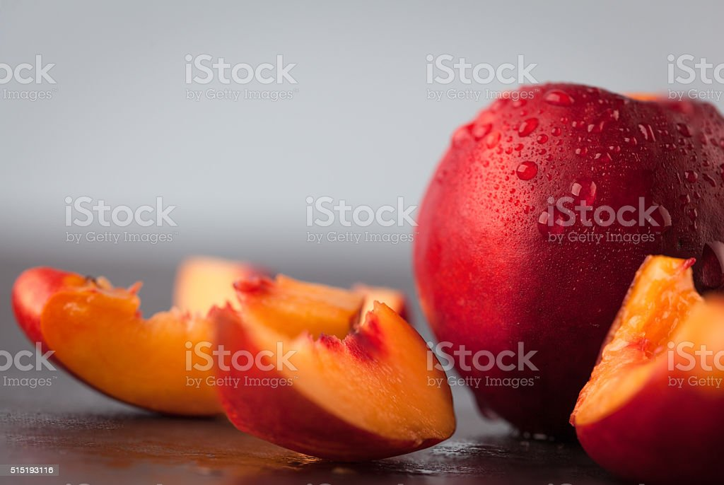 Yellow nectarine peach with water drops. stock photo