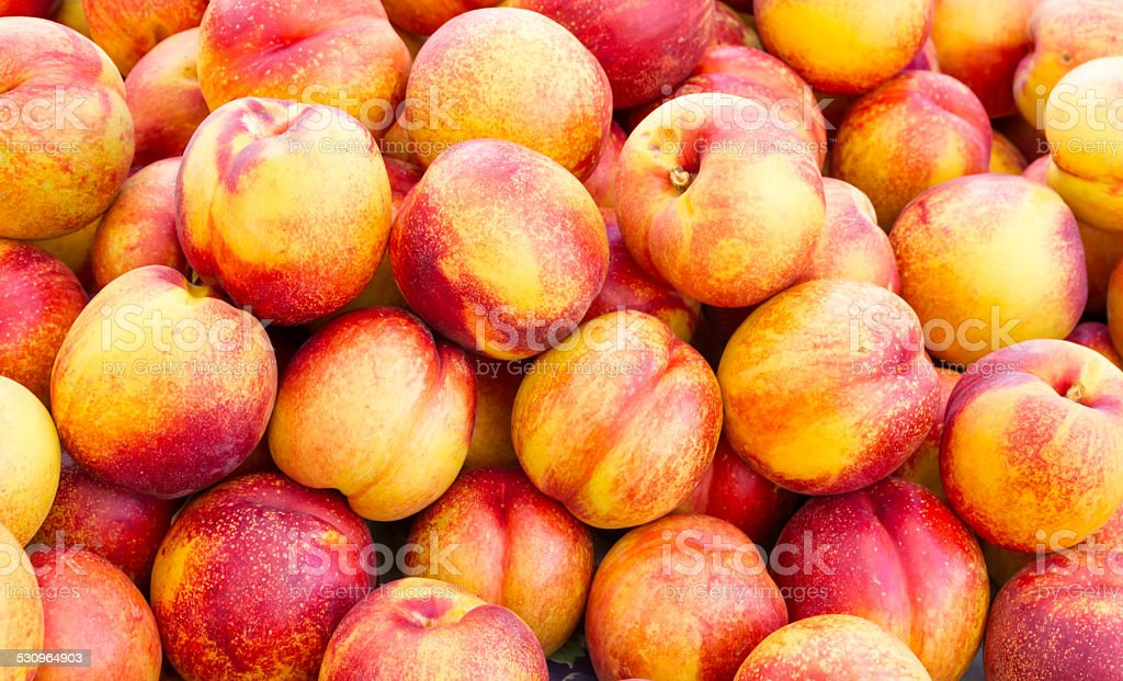 Yellow nectarines on display stock photo