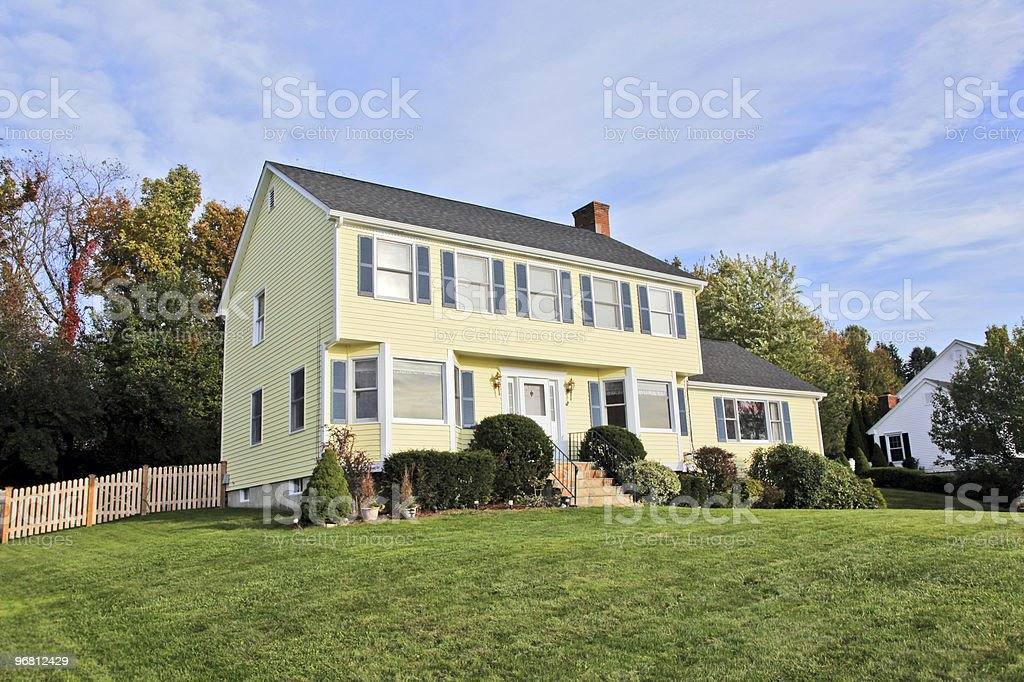 Yellow New England Style colonial house stock photo