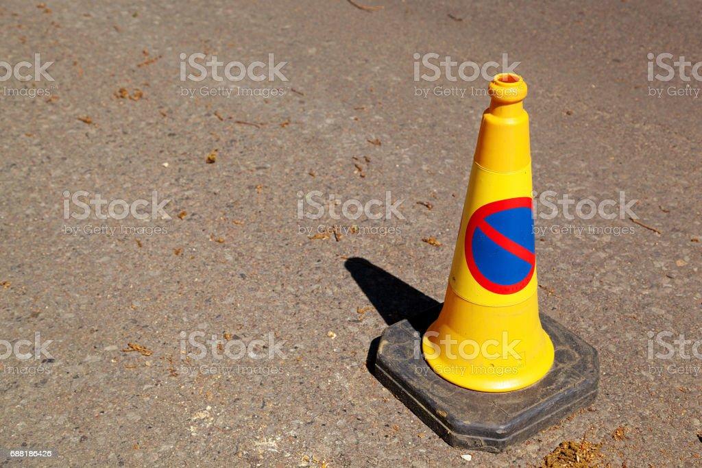 Yellow No Parking Cone stock photo