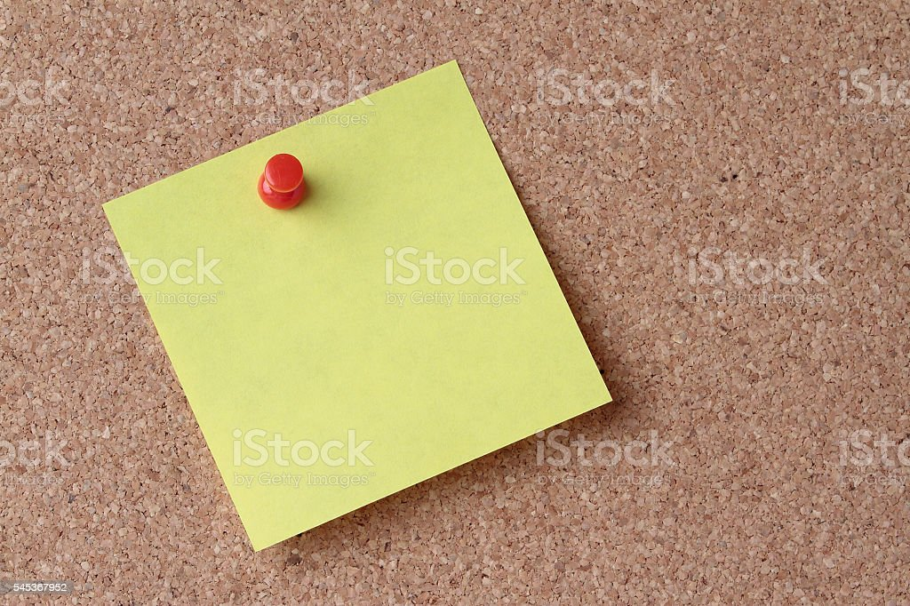 yellow note on the board stock photo
