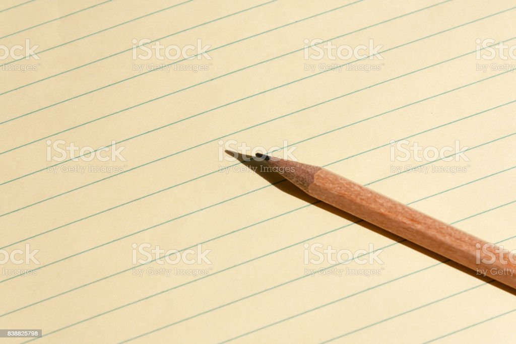 Yellow Note pad and a Pencil stock photo