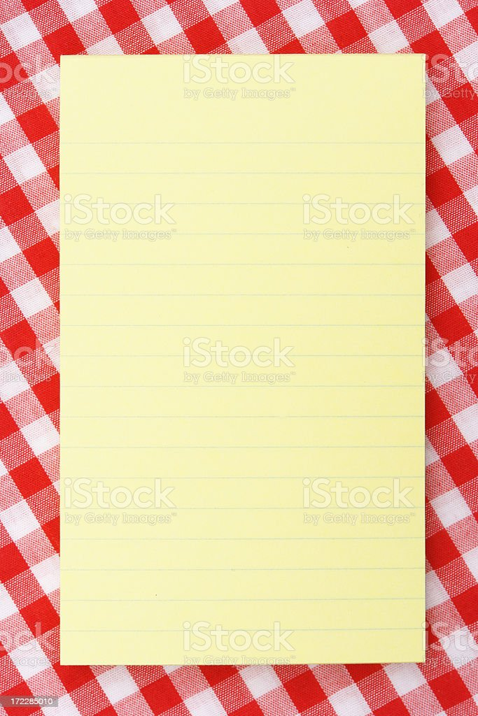 Yellow note pad on picnic table royalty-free stock photo