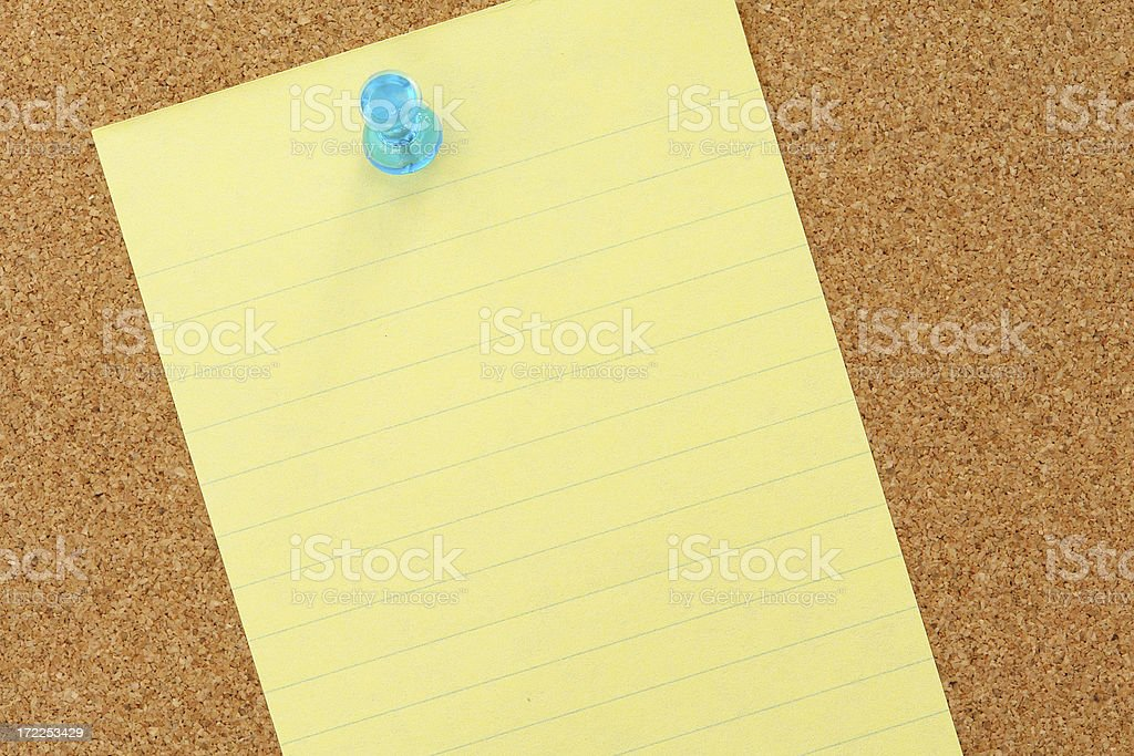 Yellow note paper on bulleting board royalty-free stock photo