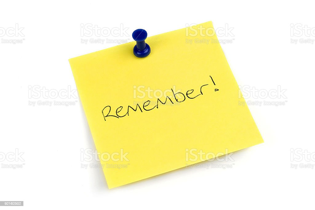 Yellow note with blue tack to remember royalty-free stock photo
