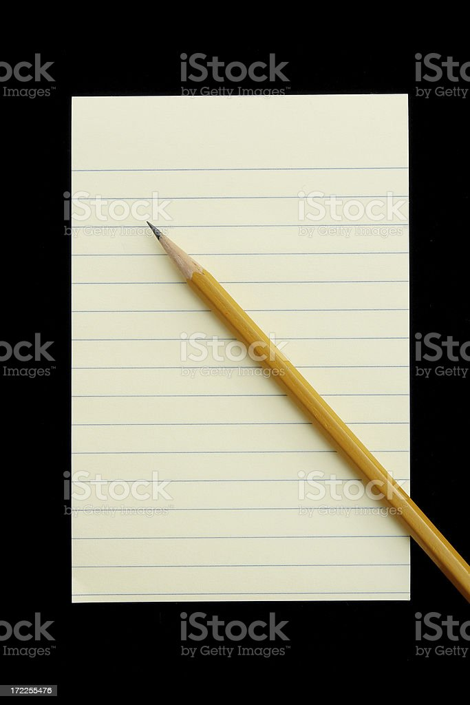 Yellow notepad on black royalty-free stock photo