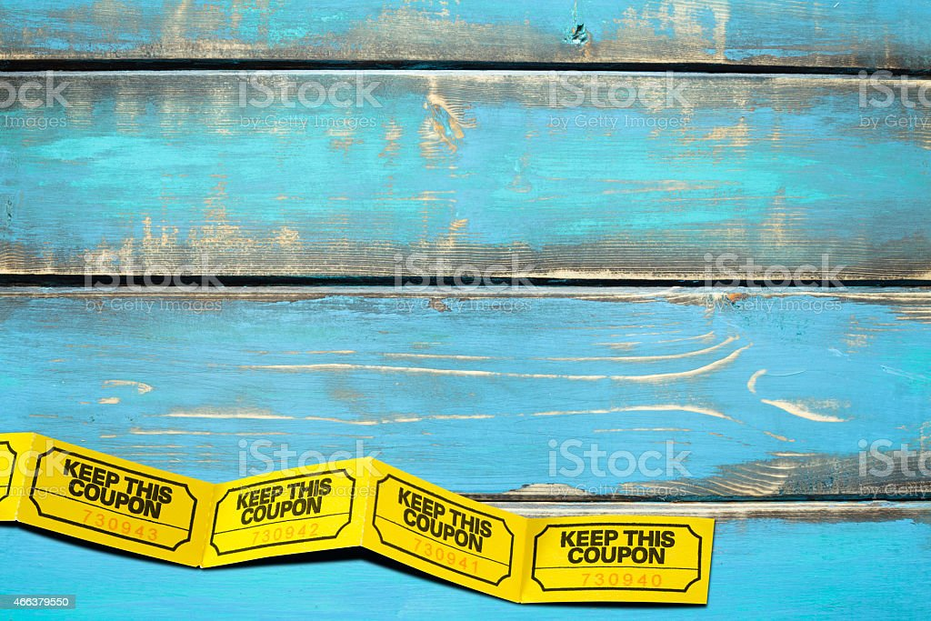 Yellow Numbered and Attached Tickets on Blue Picnic Table stock photo