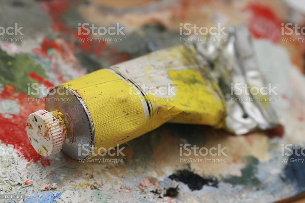 Yellow oil color on a palette royalty-free stock photo