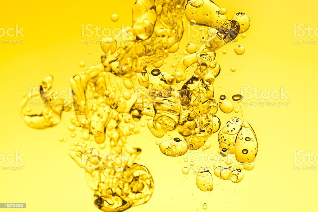 Yellow oil water background stock photo