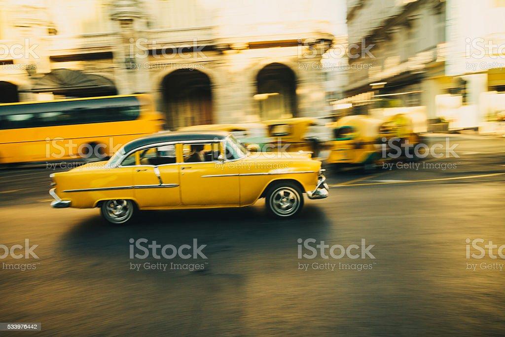 Yellow oldtimer in Havana, Cuba stock photo