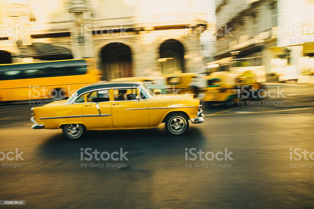 Yellow oldtimer in Havana, Cuba stock photo
