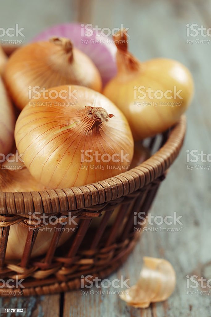 Yellow onions in the basket royalty-free stock photo