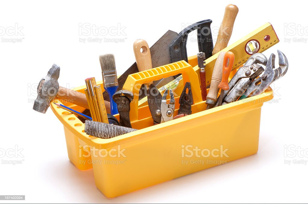Yellow open toolbox with handle filled with tools royalty-free stock photo