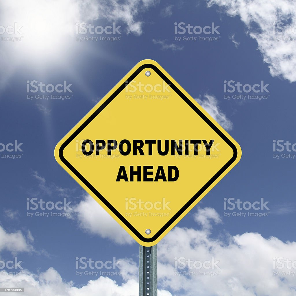Yellow opportunity ahead road sign stock photo