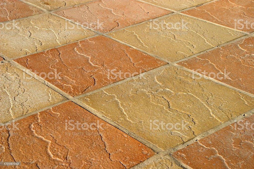 Yellow, orange floor mosaic royalty-free stock photo