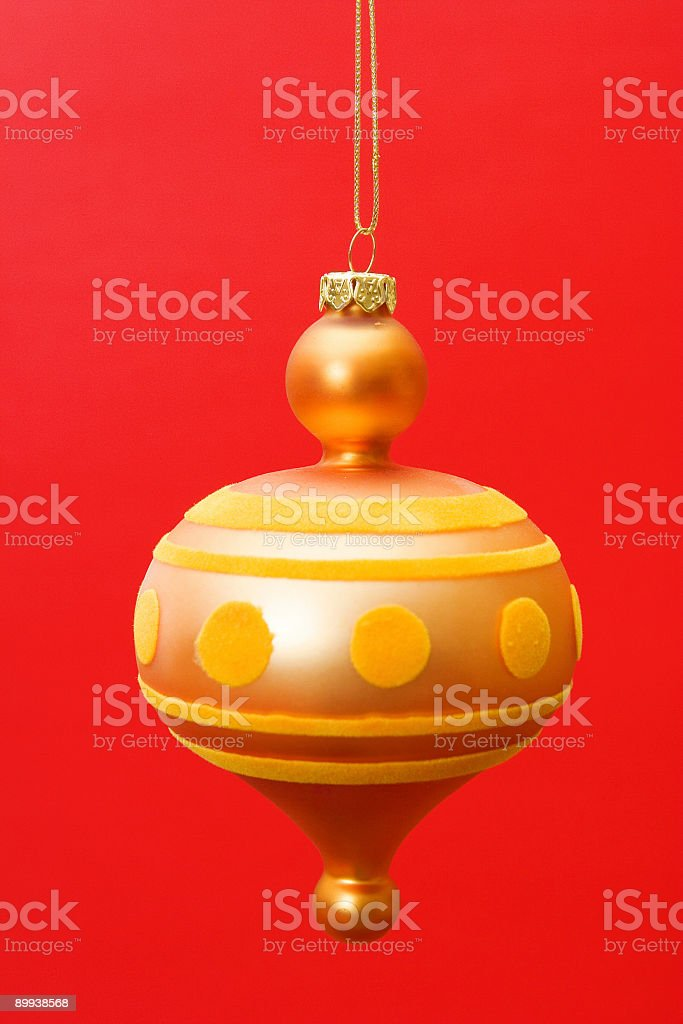 Yellow ornament on red background royalty-free stock photo