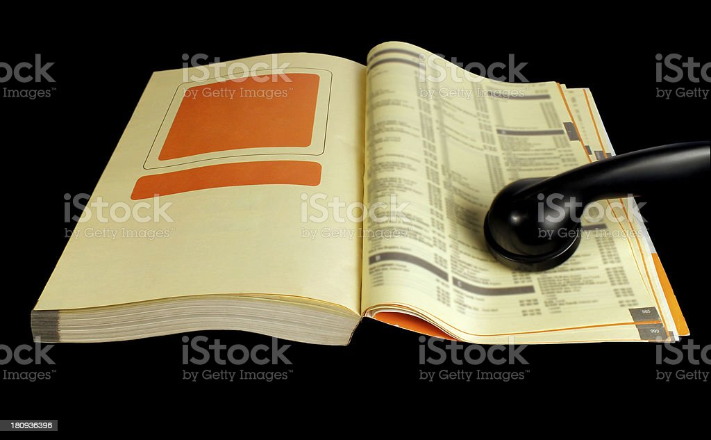 Yellow pages with phone receiver stock photo