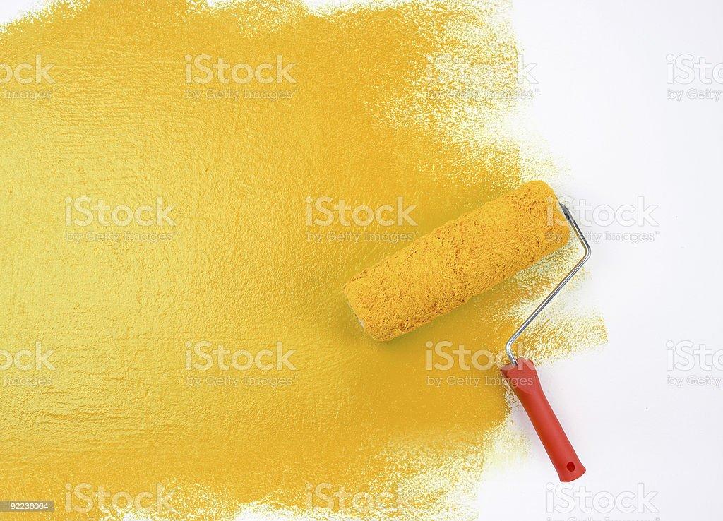 Yellow paint roller stock photo
