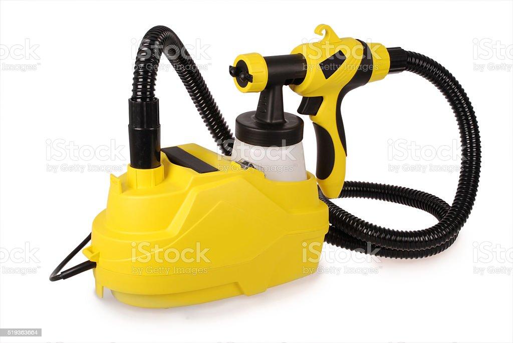 Yellow paint sprayer stock photo