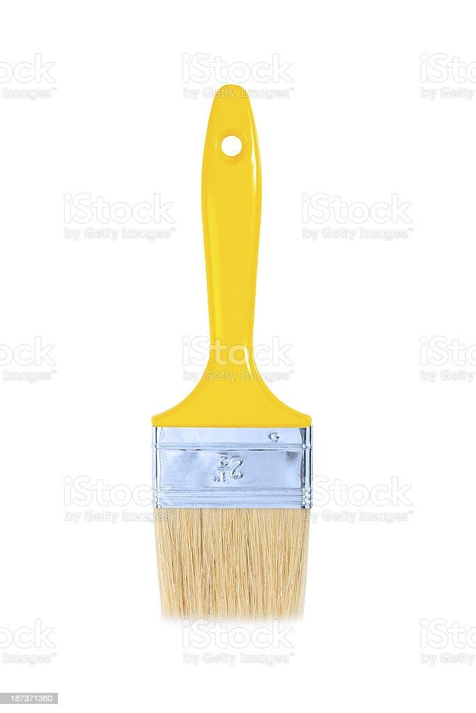yellow paintbrush isolated stock photo