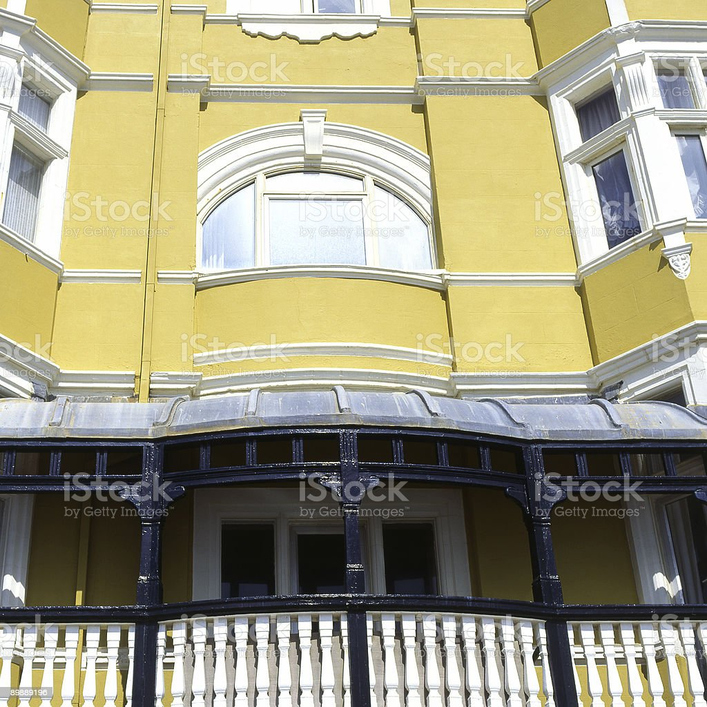 Yellow painted appartment building. Brighton. East Sussex. England royalty-free stock photo