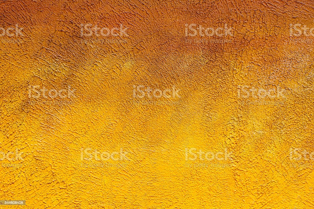 Yellow painted brick wall as background, texture stock photo