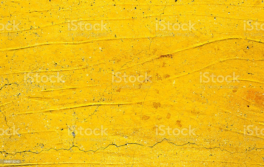 Yellow painted concrete wall texture stock photo