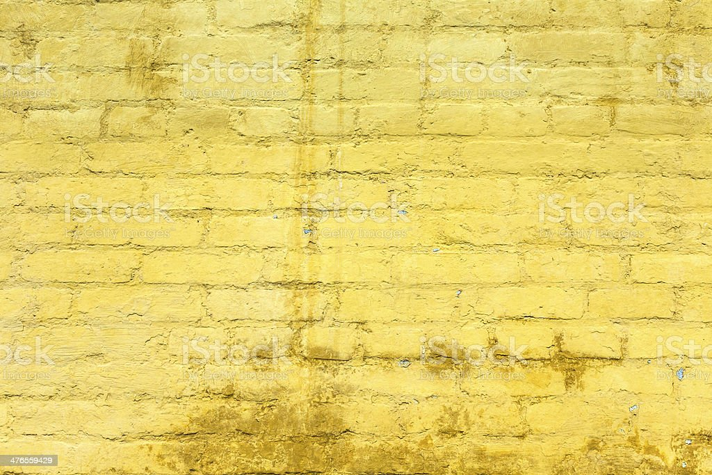 yellow painted old brick wall royalty-free stock photo