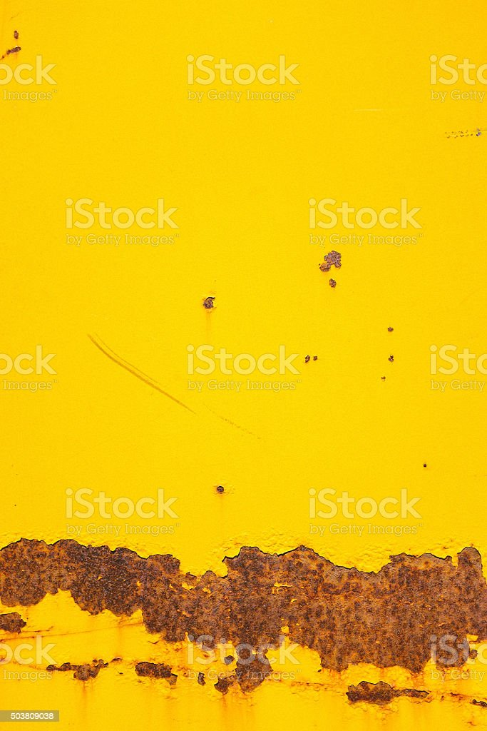 yellow painted old metal background. stock photo