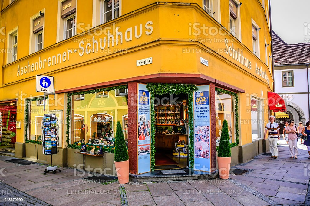 Yellow painted shoe and tourist gift store in Fussen, Germany stock photo