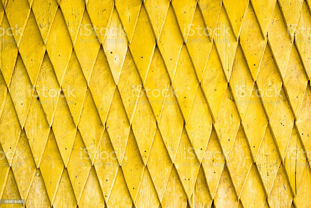 Yellow painted wooden shingle surface stock photo