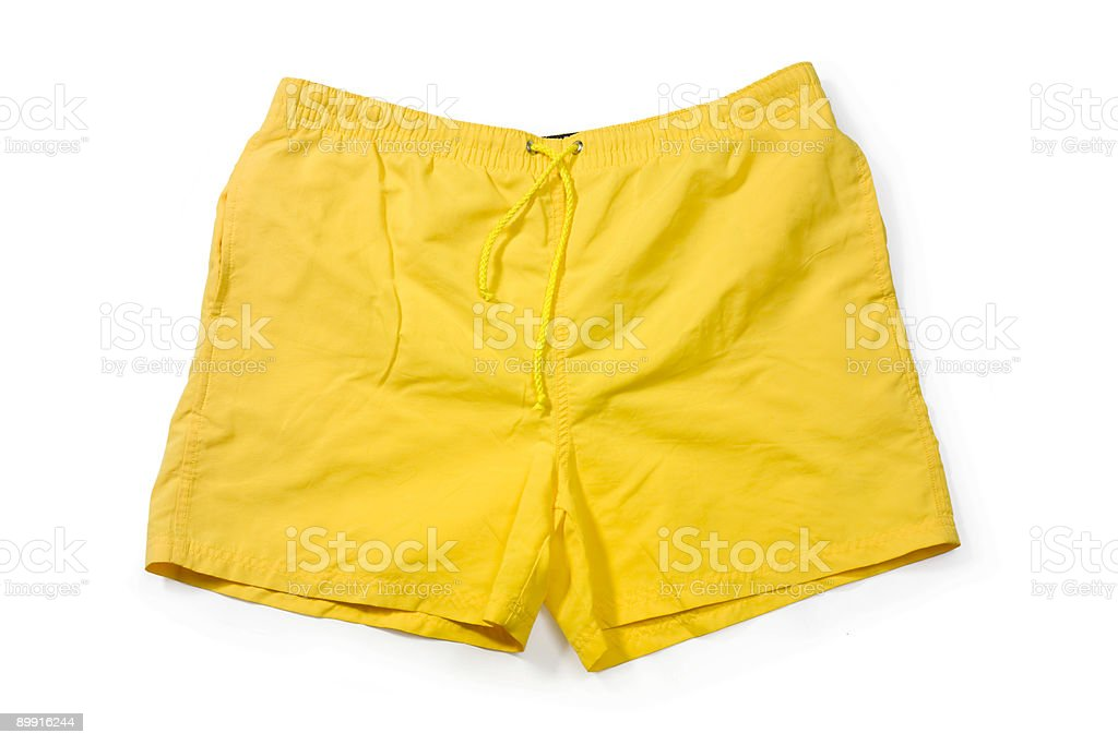 Yellow pair of swim trunks on white background stock photo