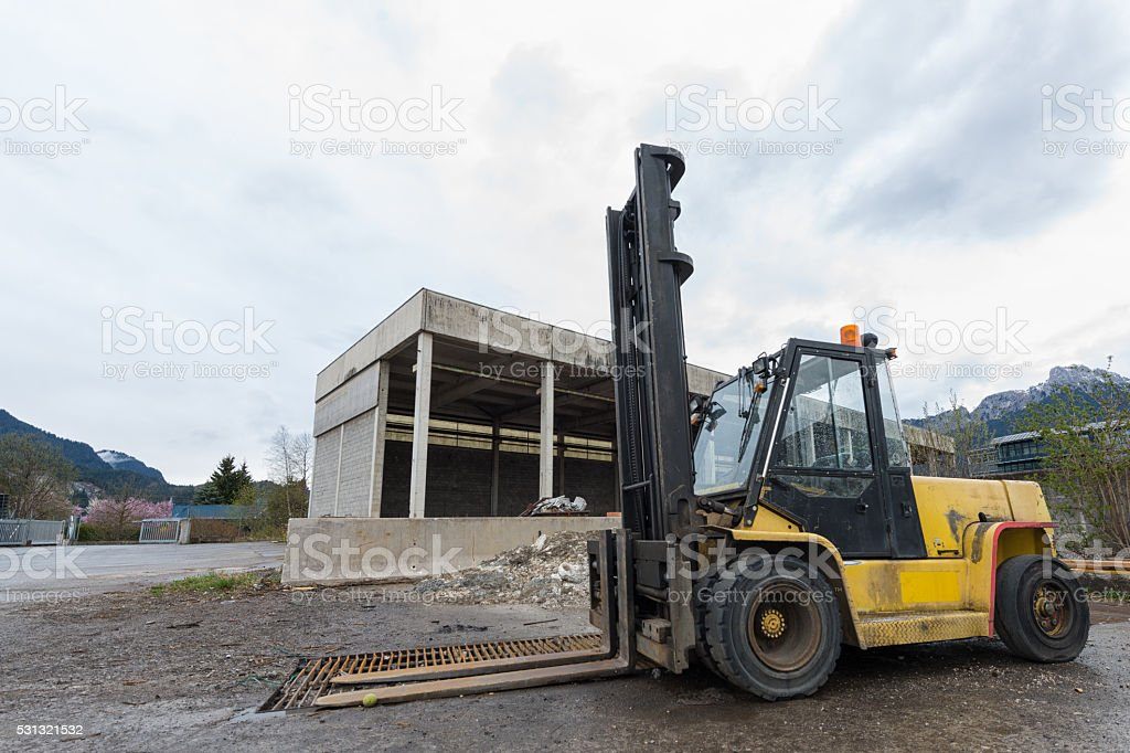 yellow pallet lift truck transporter standing at storehouse stock photo