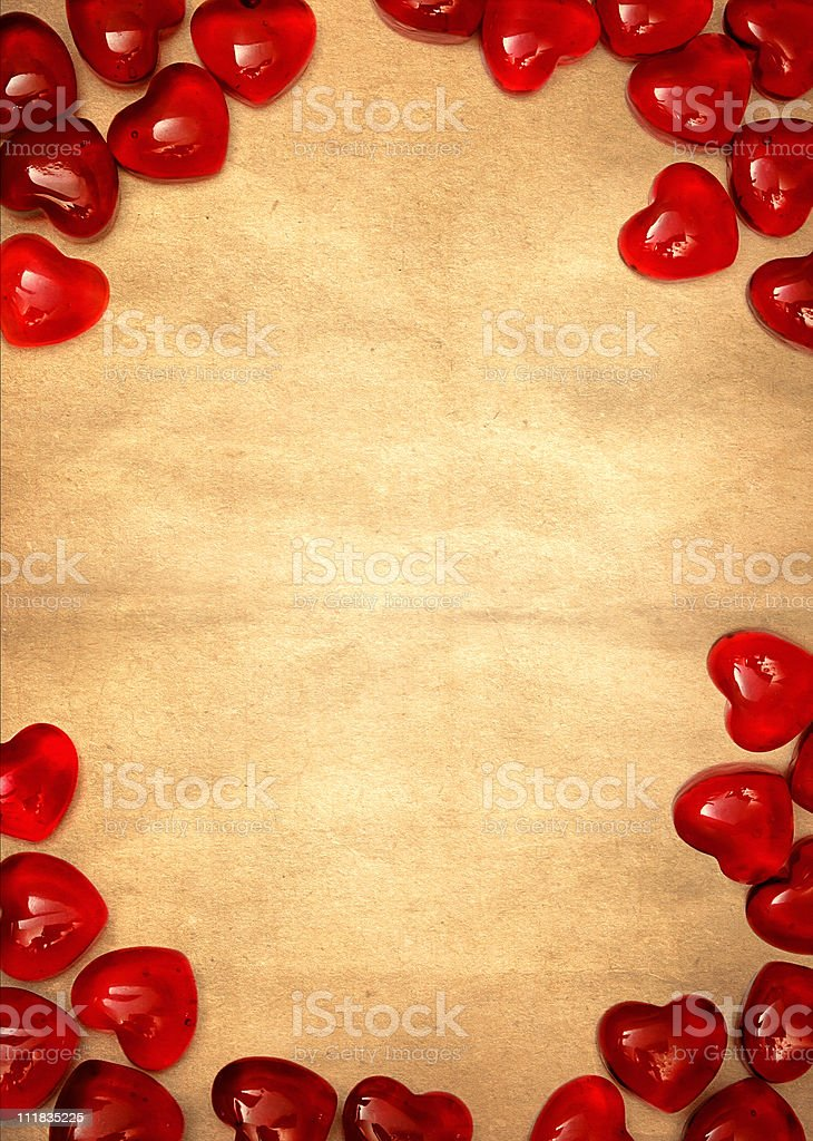 Yellow paper and red hearts stock photo