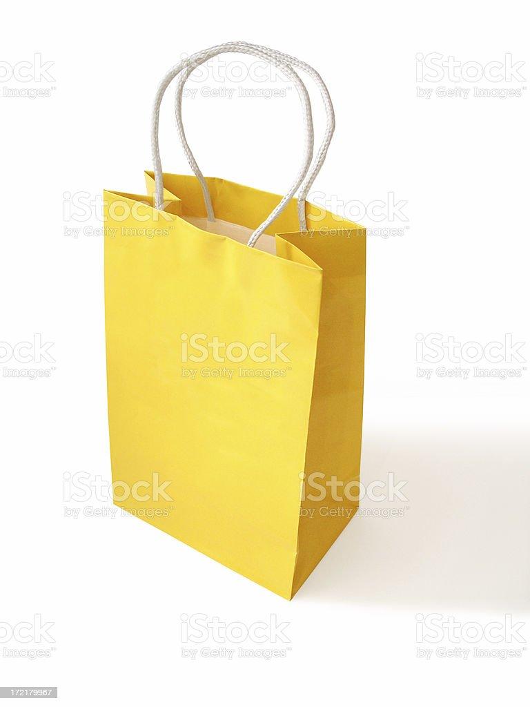 Yellow paper bag stock photo