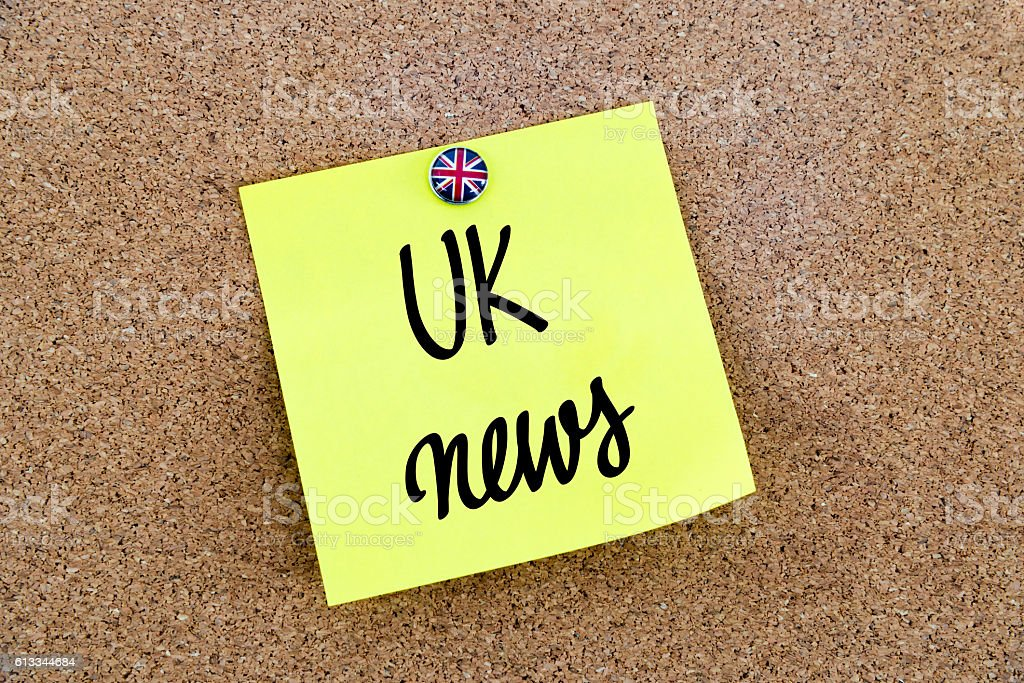 Yellow paper note with text UK News stock photo