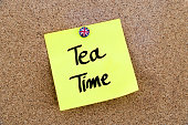 Yellow paper note with UK thumbtack and text TEA TIME