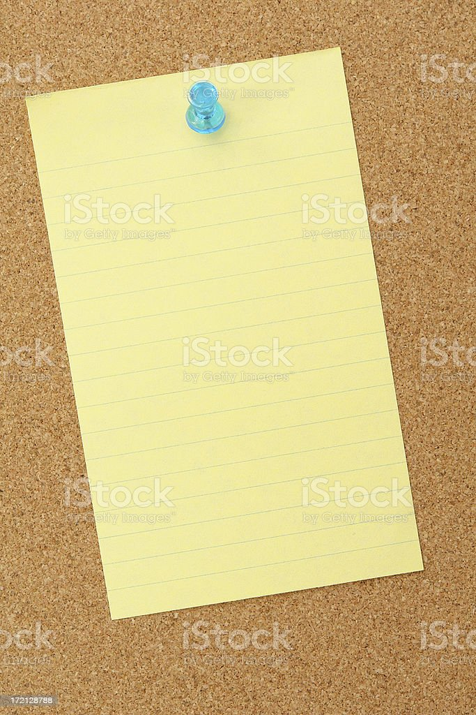 Yellow paper on corkboard royalty-free stock photo
