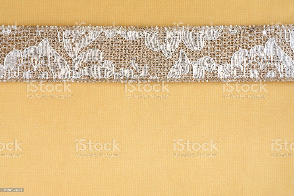 Yellow Paper with White Lace and Burlap Border stock photo