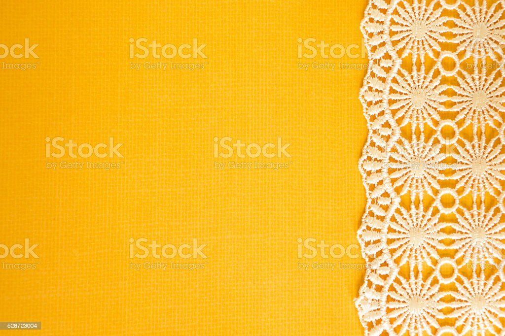 Yellow Paper with White Lace stock photo