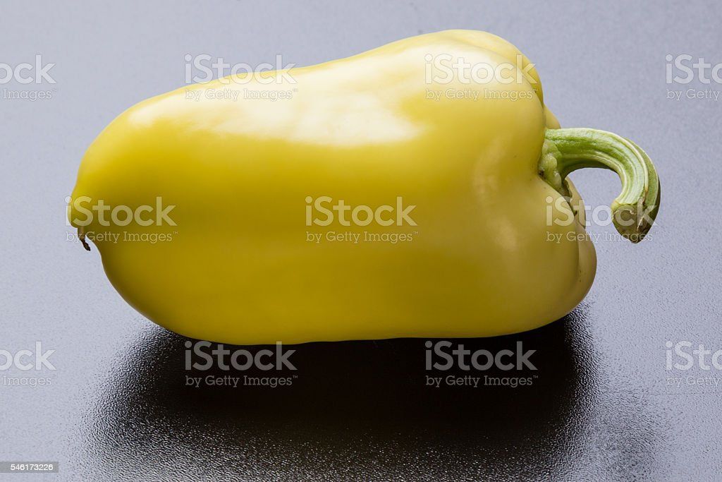 yellow paprika on black stock photo