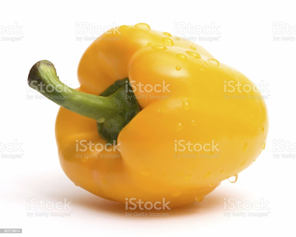 Yellow paprika with water drops over white stock photo