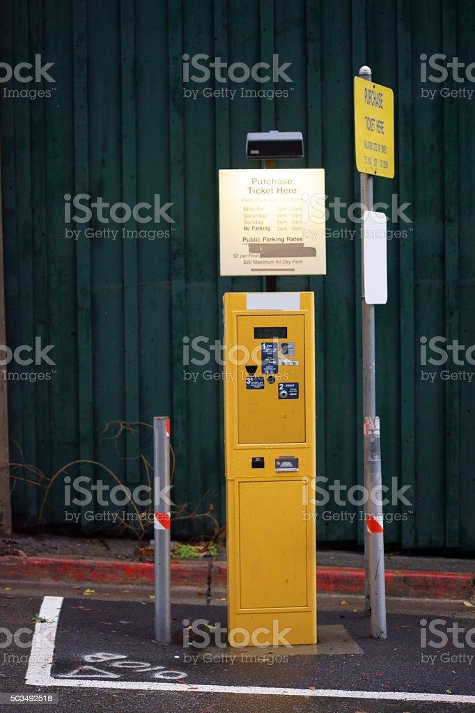 Yellow parking automat stock photo