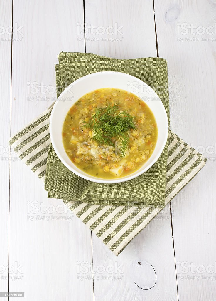 Yellow pea soup in bowl on white wooden background royalty-free stock photo