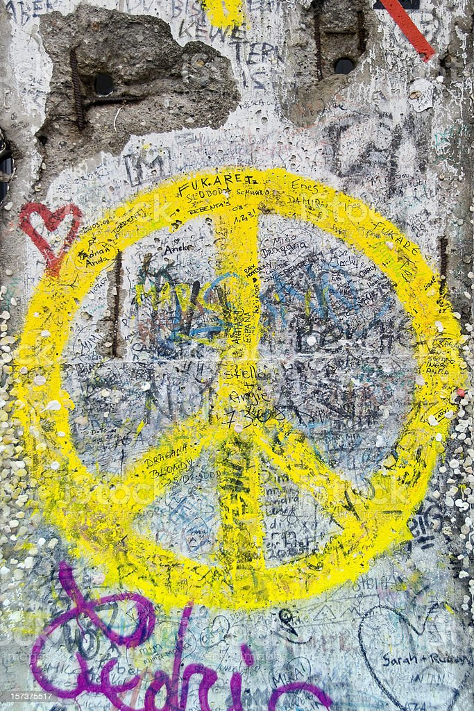 Yellow Peace Sign on Berlin Wall stock photo